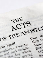 A macro detail of the book of Acts in the Christian New Testament